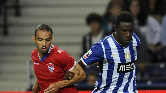 FC Porto's Silvestre Varela, right, challenges Gil Vicente's Gabriel Moura, from Brazil, in a Portuguese League soccer match at the Dragao stadium in Porto, Portugal, Saturday, Sept. 14, 2013. Varela scored once in Porto's 2-0 victory