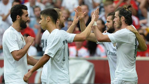 Real Madrid players celebrate the second goal scored by Welsh midfielder Gareth Bale (R) during the Audi Cup football match Real Madrid vs Tottenham Hotspur in Munich, southern Germany, on August 4, 2