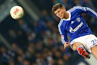 Schalke's Dutch striker Klaas-Jan Huntelaar plays the ball during a football match in Gelsenkirchen, western Germany on December 15, 2012. Schalke 04 will travel to Bavaria this weekend to face Bundesliga leaders Bayern Munich without Huntelaar, it was announced