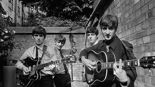 George Harrison, Ringo Starr, Paul McCartney and John Lennon of The Beatles in their London backyard.