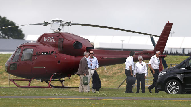 CAR: Formula One Supremo Bernie Ecclestone (2nd R) arrives by helicopter