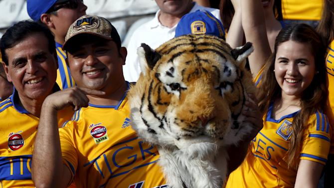 Fans of Mexico's Tigres pose for pictures before their Copa Libertadores final soccer match against Argentina's River Plate at the Universitario stadium in Monterrey