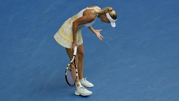 Caroline Wozniacki of Denmark reacts during her women's singles match against Garbine Muguruza of Spain (Reuters)