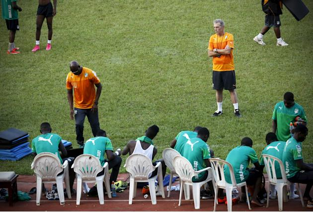 The new soccer coach of African champions, Ivory Coast, Michel Dussuyer (top R), attends a training session at the Felix Houphouet-Boigny stadium in Abidjan, Ivory Coast