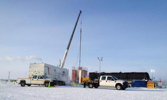 A new pump is installed to help manage wellhead pressure at a test of methane hydrate production technology in Alaska's North Slope.