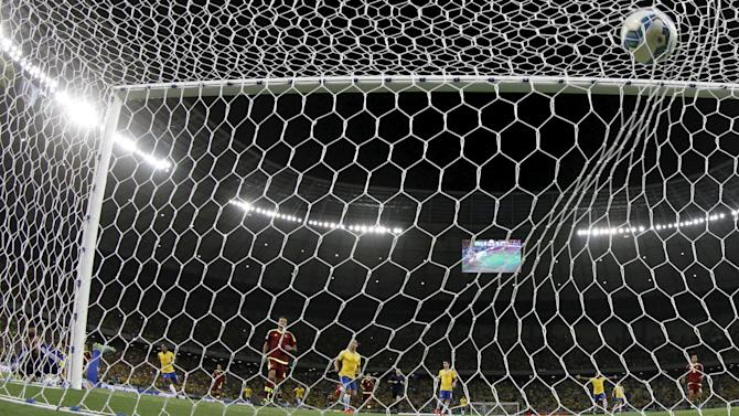 Alain Baroja of Venezuela looks at a goal scored by Willian of Brazil during their 2018 World Cup qualifying soccer match in Fortaleza, Brazil