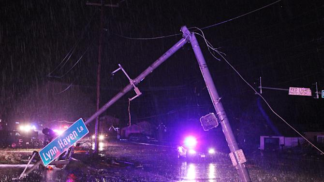 "The street light at Howdershell Road and Lynn Haven Lane lies damaged following high winds from a strong spring storm in Hazelwood late Wednesday evening, April 10, 2013. Butch Dye, a hydrometeorological technician with the National Weather Service in St. Louis, Mo., said severe weather struck the suburb of Hazelwood.  ""We won't be able to confirm whether it was a tornado until teams get out there tomorrow,"" Dye said.  (AP Photo/Erik M. Lunsford, Post-Dispatch)"
