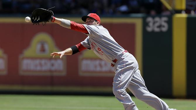Cincinnati Reds first baseman Joey Votto is unable to grab a ball hit for a single by Texas Rangers' Engel Beltre in the third inning of a baseball game Sunday, June 30, 2013, in Arlington, Texas. (AP Photo/Tony Gutierrez)