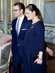 Sweden's Crown Princess Victoria, right, and Prince Daniel, left, arrive for a luncheon with Finland's president, not pictured, in Stockholm's Royal Palace on Tuesday Feb. 21, 2012. The crown princess is pregnant and the couple are expecting their first child in March 2012. (AP Photo/Pontus Lundahl) SWEDEN OUT