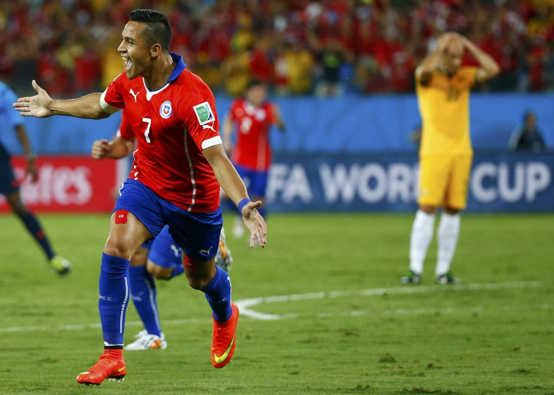 Chile's Sanchez celebrates after scoring a goal during their 2014 World Cup Group B soccer match against Australia at the Pantanal arena in Cuiaba