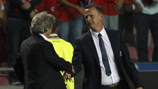 Benfica's coach Jesus and Anderlecht's coach van den Brom shake hands after their Champions League soccer match at the Luz Stadium in Lisbon