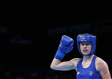Taylor of Ireland reacts after winning her women's 60kg Light weight boxing gold medal fight at the 1st European Games in Baku