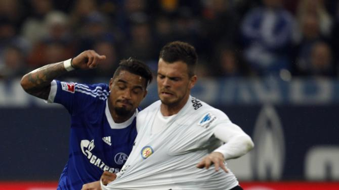 Schalke 04's Boateng challenges Eintracht Braunschweig's Ademi during their German first division Bundesliga soccer match in Gelsenkirchen