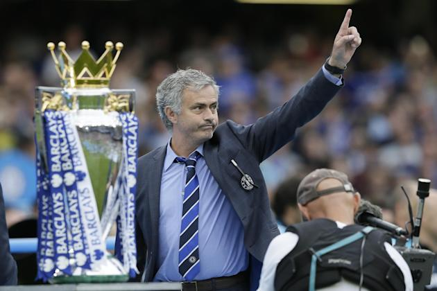Chelsea Manager Jose Mourinho waves to the crowd after the English Premier League soccer match between Chelsea and Sunderland at Stamford Bridge stadium in London, Sunday, May 24, 2015. Chelsea were a