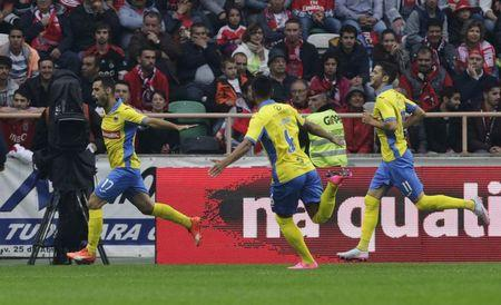 Arouca's Rodrigo celebrates his goal against Benfica with his team mates Lima and Ivo during their Portuguese Premier League soccer match at Municipal stadium in Aveiro