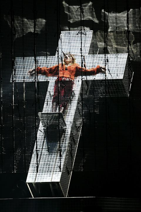 Help! A 50 year old woman is chained to a moving cross! Oh it's just Madonna