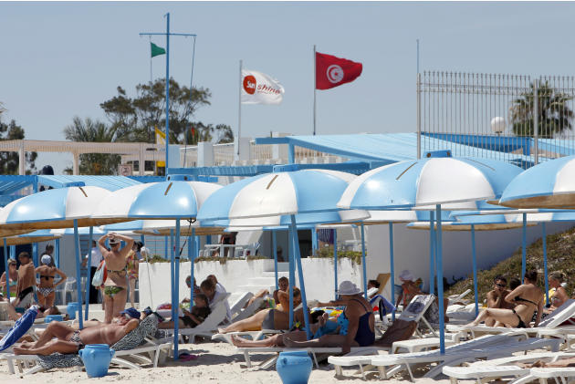 Tourists sunbathe at the Mediterranean resort of Sousse, Tunisa, four days after Friday's terrorist attack, Tuesday, June 30, 2015. One of Tunisia's top security officials says the gunman who