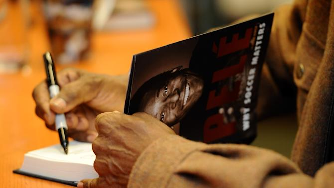 "Pele Signs Copies Of ""Why Soccer Matters"""