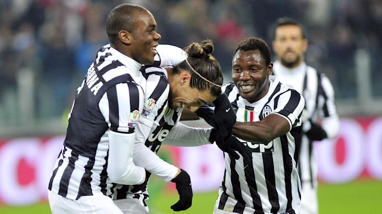 Juventus defender Martin Caceres, center, of Uruguay, celebrates with teammates after scoring during an Italian Cup soccer match between Juventus and Avellino at the Juventus stadium, in Turin, Italy, Wednesday, Dec. 18, 2013