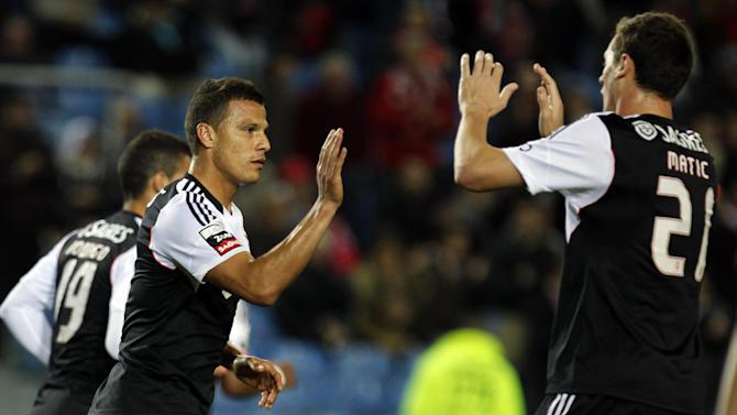 Benfica's Lima, left, from Brazil, celebrates with teammate Nemanja Matic, from Serbia, after scoring their side's first goal against Olhanense during a Portuguese league soccer match between Benfica and Olhanense at the Algarve stadium in Faro, southern Portugal, Sunday, Dec. 15, 2013. Lima and Matic scored once each in Benfica's 3-2 victory
