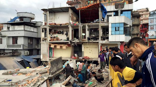 Nepal Earthquake Topples Buildings Killing 876