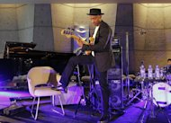U.S jazz musician Marcus Miller performs during the international Jazz Day at the UNESCO headquarters in Paris, Friday April. 27, 2012. during . (AP Photo/Jacques Brinon)