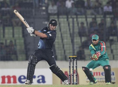 New Zealand's Corey Anderson plays a ball as Bangladesh's captain and wicket keeper Mushfiqur Rahim watches during their first one-day international (ODI) cricket match in Dhaka.