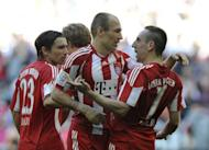 Bayern Munich's players celebrate scoring a goal during their German first division Bundesliga match vs Borussia Moenchengladbach, in the southern German city of Munich, on April 2. Defending champions Bayern Munich are up to third in the table and are at Nuremberg in the Bavarian derby on Saturday