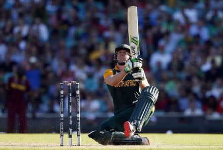South Africa's AB de Villiers hits a boundary during the Cricket World Cup match against the West Indies at the SCG