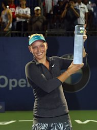 KUALA LUMPUR, MALAYSIA - APRIL 20: Donna Vekic of Croatia poses with her trophy after defeating Dominika Cibulkova of Slovakia in the singles final during day three of the Malaysian Tennis Open at The Royal Selangor Golf Club on April 20, 2014 in Kuala Lumpur, Malaysia. (Photo by How Foo Yeen/Getty Images)