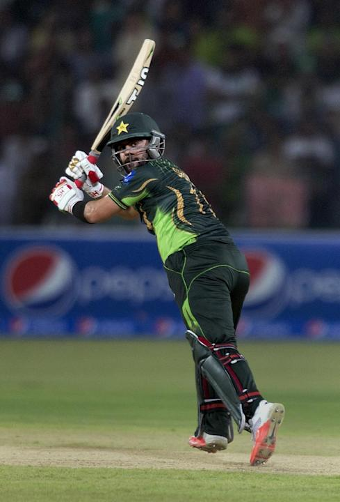 In this Friday, May 22, 2015 photo,  Pakistan's Ahmed Shehzad plays a shot during the first T-20 match against Zimbabwe at the Gaddafi stadium in Lahore, Pakistan. Pakistan opening batsmen Shehzad