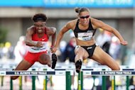 Lolo Jones (R) compete in the women's 100m hurdles final at the US Olympic Track and Field Team Trials on June 23. Jones, who led at the Beijing final before stumbling over the penultimate hurdle, qualified for London in the 100 hurdles