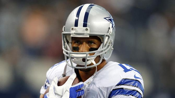 In this Aug. 24, 2013, file photo, Dallas Cowboys wide receiver Miles Austin holds a football before a preseason NFL football game against the Cincinnati Bengals in Arlington, Texas. The Cowboys released Austin on Wednesday, March 12, 2014, designating it as a June 1 cut