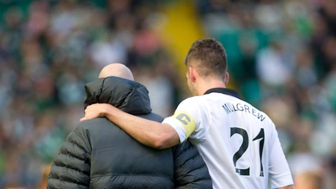 Charlie Mulgrew went off injured during Celtic's victory over Hearts