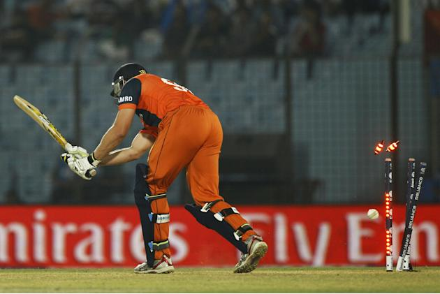 Netherlands' Mudassar Bukhari is bowled out by Sri Lanka's Lasith Malinga during their ICC Twenty20 Cricket World Cup match in Chittagong, Bangladesh, Monday, March 24, 2014. (AP Photo/A.M. Ah