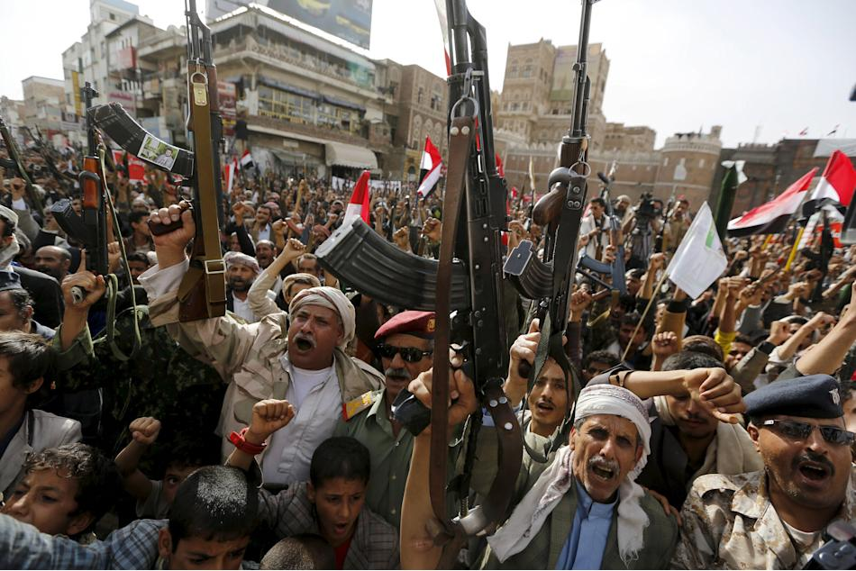 Armed Houthi followers rally against Saudi-led air strikes in Sanaa