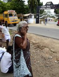 In this Thursday Oct. 13, 2011, photo, Arputhammal, the mother of Arivu Perarivalan, one of the three convicted in the 1991 assassination of former Indian Prime Minister Rajiv Gandhi, speaks on a mobile phone outside Vellore prison, where her son has been imprisoned, in Chennai, India. iAcross most of India the three men on death row in the assassination of Gandhi are reviled as murderous traitors to the nation. But many Tamils, a major ethnic group in southern India, see things very differently. (AP Photo/Nathan G.)