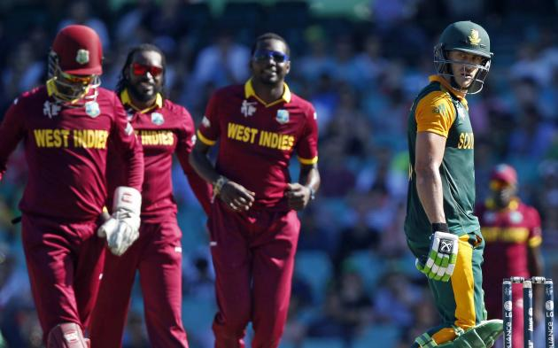 South Africa's Faf du Plessis looks back at West Indies wicketkeeper Denesh Ramdin after he caught him out for 62 runs during their Cricket World Cup match at the SCG