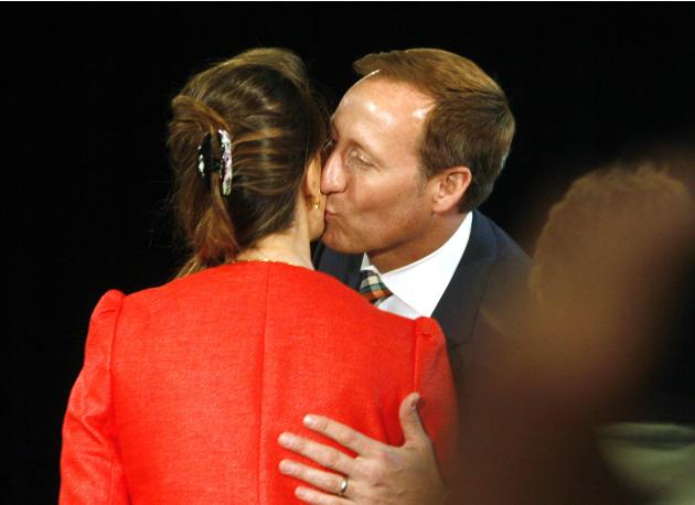 Federal Justice Minister Peter MacKay kisses his wife, Nazanin Afsham Jam before press conference announcing his  retirement in Stellarton