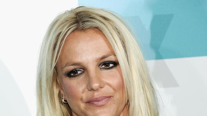 "FILE - In this May 14, 2012 file photo, new ""X Factor"" judge Britney Spears attends the FOX network upfront presentation party at Wollman Rink, in New York. Jurors were selected in a case against the singer's parents and conservators with opening statements expected to begin Thursday Oct. 18, 2012, in Los Angeles. (AP Photo/Evan Agostini, File)"