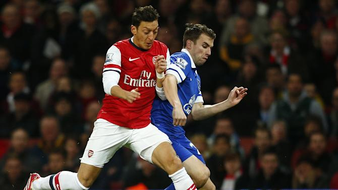 Everton's Coleman challenges Arsenal's Ozil during their English Premier League soccer match at The Emirates in London
