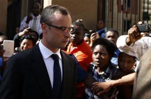 Olympic and Paralympic track star Oscar Pistorius leaves after his trial for the murder of his girlfriend Reeva Steenkamp, at the North Gauteng High Court in Pretoria