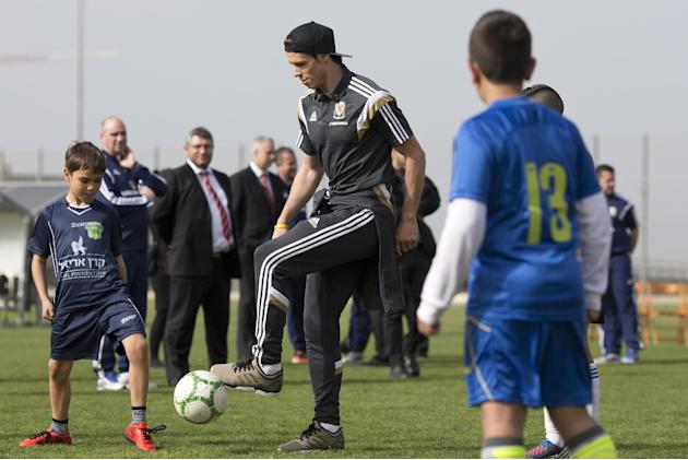 Wales international and Real Madrid soccer player Gareth Bale controls the ball with children during an event with Jewish and Arab children from communities in northern Israel, in Haifa, Israel, Sunda