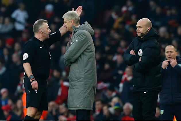 Arsenal's manager Arsene Wenger (2nd L) is sent to the stands by referee Jonathan Moss (L) as fourth official Anthony Taylor (R) looks on during the English Premier League football match between A