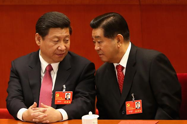 BEIJING, CHINA - NOVEMBER 14: China's Vice President Xi Jinping (L) and Chairman of the Chinese People's Political Consultative Conference Jia Qinglin (R) talk during the closing session of the 18th National Congress of the Communist Party of China (CPC) at the Great Hall of the People on November 14, 2012 in Beijing, China. Members of the Standing Committee of the Political Bureau of the new CPC Central Committee will meet with journalists on November 15, 2012. (Photo by Feng Li/Getty Images)