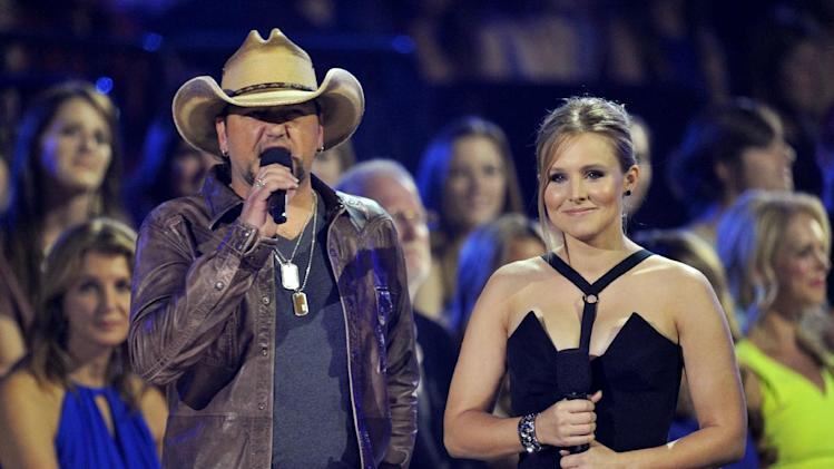 Jason Aldean, left, and Kristen Bell speak in the audience at the 2013 CMT Music Awards at Bridgestone Arena on Wednesday, June 5, 2013, in Nashville, Tenn. (Photo by Donn Jones/Invision/AP)