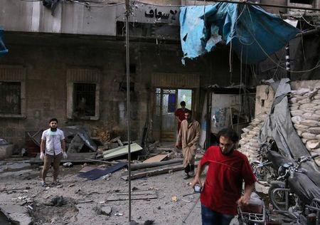 Medics inspect the damage outside a field hospital after an airstrike in the rebel-held al-Maadi neighbourhood of Aleppo