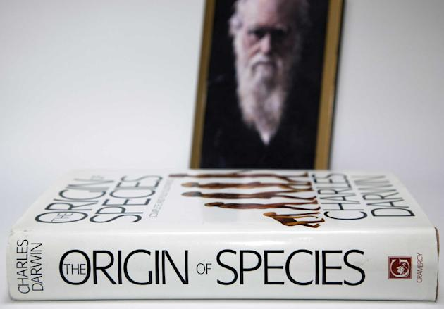 Portrait of Charles Darwin and his seminal The Orgin of Species