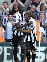 Newcastle United's Demba Ba (L) celebrates with Yohan Cabaye after scoring during their English Premier League match against Tottenham Hotspur on August 18. Newcastle manager Alan Pardew is likely to rest key players with Saturday's trip to Chelsea in mind