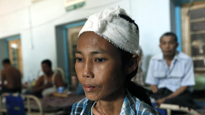 A woman, injured during ethnic unrest between Buddhists and Muslims, receives medical treatment in a hospital in Meikhtila, Mandalay division, about 550 kilometers (340 miles) north of Yangon, Myanmar, Saturday, March 23, 2013.  Myanmar's army took control of the ruined central city on Saturday, regaining control after several days of clashes between Buddhists and Muslims that killed dozens of people and left scores of buildings in flames in the worst sectarian bloodshed to hit the Southeast Asian nation this year.  (AP Photo/Khin Maung Win)